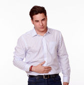 Handsome man with stomach pain standing — Stockfoto