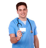 Professional nurse man holding a blank card — Stock Photo