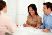 Young couple working with financial advisor — Stock Photo