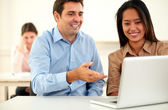 Adult guy and woman working on laptop — Stock Photo