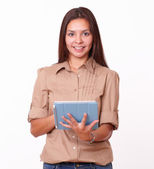 Alone friendly girl using her tablet pc — Stock Photo