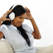 Young woman listening to music and having fun — Stock Photo #9721090