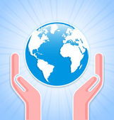 Caring hands with planet Earth — Stock Vector