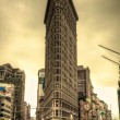 Flatiron Building & Yellow Sky - Stock Photo