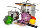 Food and shiny metal saucepan — Stock Photo