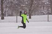 Running in the snow storm — Stock Photo