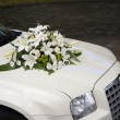 Stock Photo: Wedding car with flowers on bonnet