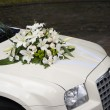 Wedding car with flowers on the bonnet — Stock Photo