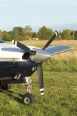 Airplane front view with propeller — Stock Photo