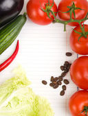 Vegetables around paper for notes — Stock Photo