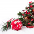 Red ball and christmas tree on white — Stock Photo