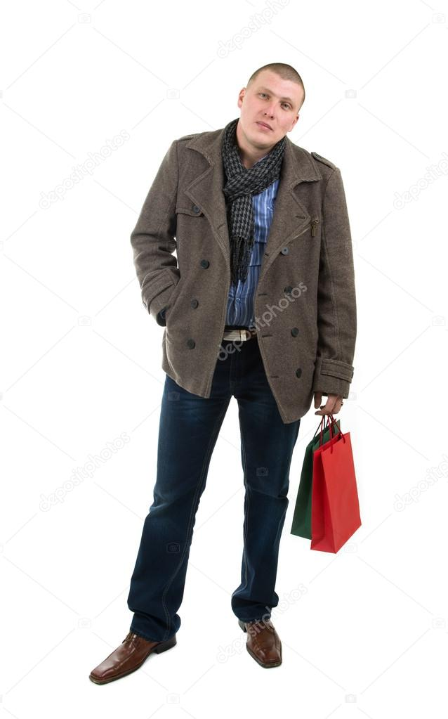 Image of young man holding shopping bags  Stock Photo #15876727