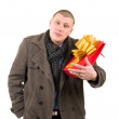 Young man with present bag — Stock Photo