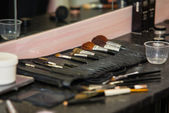 Makeup table with brushes — Stock Photo