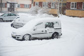 Cityscape - parked cars covered with snow — Stock Photo