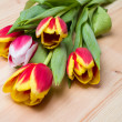 Flowers tulips on wooden background - Stock Photo