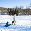 Mother and child in winter park - Stock Photo