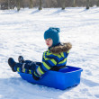 Kid in winter park - Stock Photo