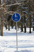 Pedestrian sign in winter park — Stock Photo