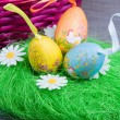 Easter eggs with basket - Stock Photo