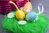 Easter eggs with basket — Stock Photo