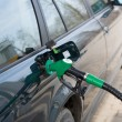 Car fill up fuel at gas station - Stock Photo