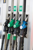 Detail of hoses of petrol pump at a gas station, selective focus — Stock Photo