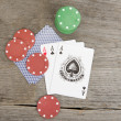 Stock Photo: Playing cards and poker chips on wooden background