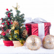 Small chrystmas trees, present box with selective focus — Stock Photo
