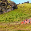 Stock Photo: Old wooden red abandoned barn in greed meadow, Iceland