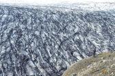 Vatnajokull glacier and lonely man taking photograph — Stock Photo