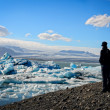 Ice lagoon and iceberg lake and person — Stock Photo