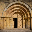 Stock Photo: Stone church entrance door and arcs