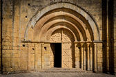 Stone church entrance door and arcs — Stock Photo