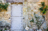 Provence white door with metal bars — Stock Photo