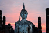 Detail of sitting Buddha at sunset in Sukhothai, Thailand — Stock Photo