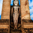 Royalty-Free Stock Photo: Statue of standing Buddha in Sukhothai historical park, Thailand