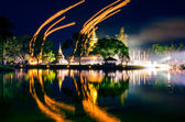 Light lampions at night above buddhist temple in Sukhothai histo — Stock Photo