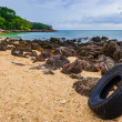 Washed out tyre at beautiful ocean coast in Andaman sea — Stock Photo