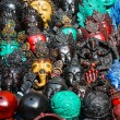 Detail of various wooden carved masks — Stock Photo
