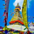 Bouddhanath stupa and buddhist flags - Stock Photo
