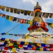 Bouddhanath stupa and colorful buddhist flags - Stock Photo