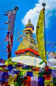 Bouddhanath stupa and buddhist flags — Stock Photo