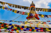 Bouddhanath stupa and colorful buddhist flags — Stock Photo