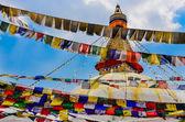 Bouddhanath stupa and colorful buddhist flags — Stock Photo