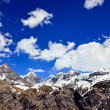 Himalayas mountains range snow peaks and clouds — Stock Photo