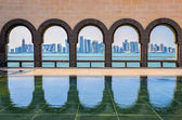 Doha skyline through the arches of the Museum of Islamic art, Do — Stock Photo