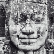 Detail of stone face in Bayon temple at Angkor Wat — Stock Photo #27012483