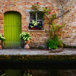 Stock Photo: Vintage old wall with green door and flowers