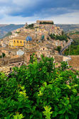 View of beautiful village Ragusa with green tree foreground — Stock Photo